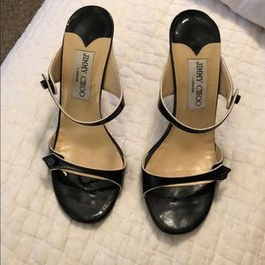 Adorable black Jimmy Choo heels with white trim